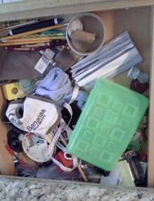 cluttered kitchen drawer makes things hard to find