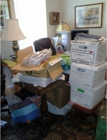 home office cluttered with paper and full of unused space