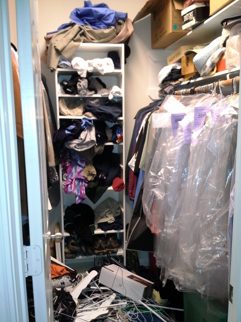 man's closet before organization
