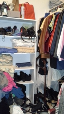 woman's closet before organization